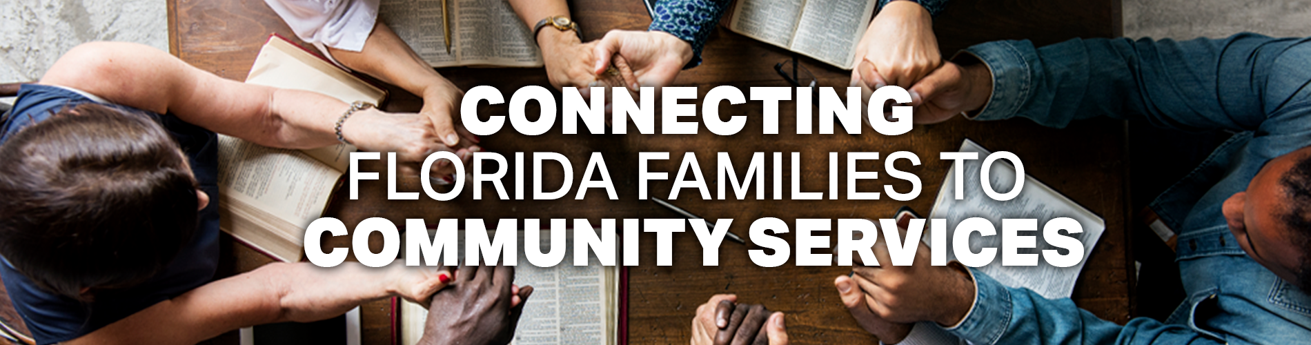 Connecting Florida Families to Community Services.  Image of group praying